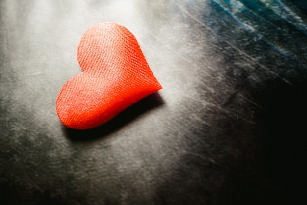 Red hearts isolated on dark background, concept of cardiovascular health or for valentines.
