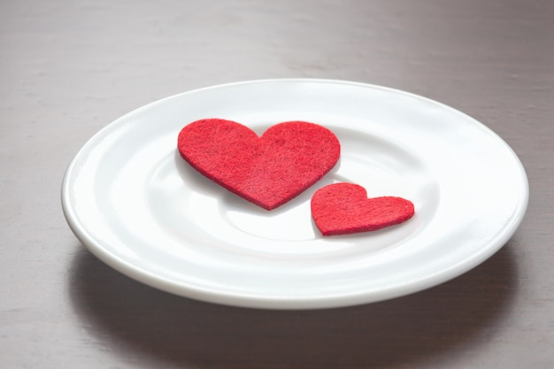 Red hearts on a plate