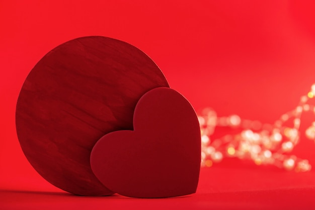 Red hearts on a red background and bokeh concept of valentines day wedding