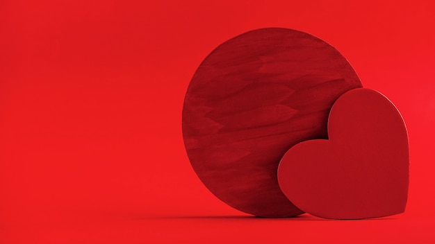 Red hearts on a red background concept of valentines day wedding copy space