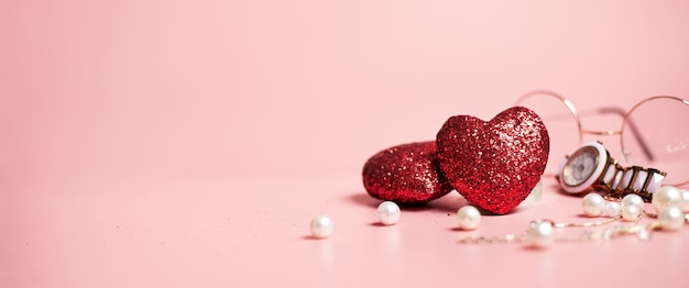 Red hearts shiny, valentine's day fashion concept, on pink background, copy space, banner. high quality photo