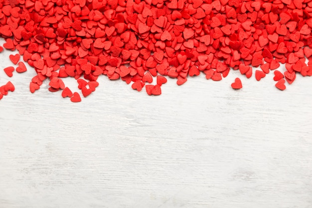 Red hearts on a white background. top view, copy space