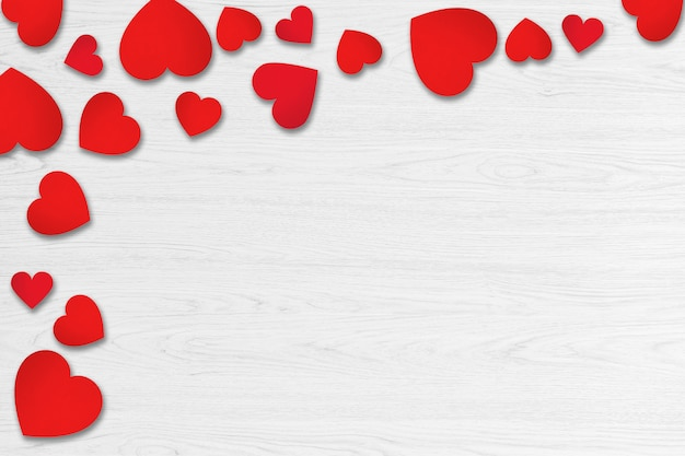 Red hearts on white wood background. valentines day concept.