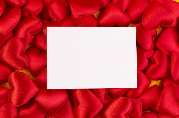 Red hearts with card , valentines day background