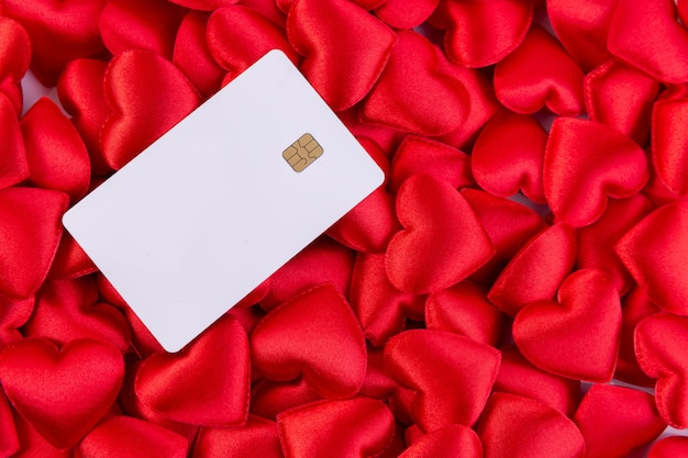 Red hearts with credit card, valentines day background