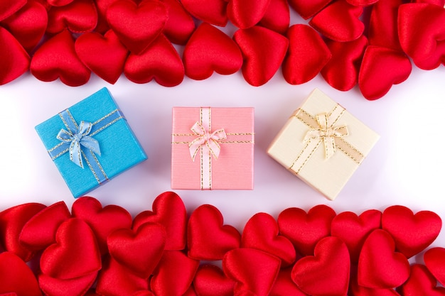 Red hearts with gift box, valentines day background concept.
