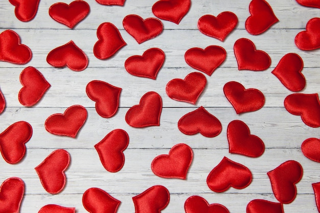 Red hearts on a wooden background, concept of love and loyalty