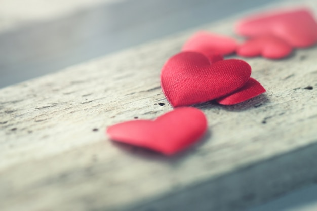 Red hearts on a wooden board