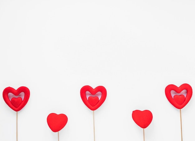 Red hearts on wooden sticks