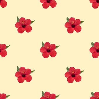 Red hibiscus flower pattern on yellow background