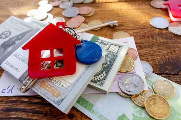 Red home house keys on the banknotes and coins