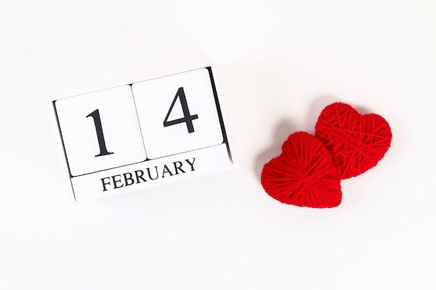 Red homemade diy heart made cardboard, yarn, wooden perpetual calendar