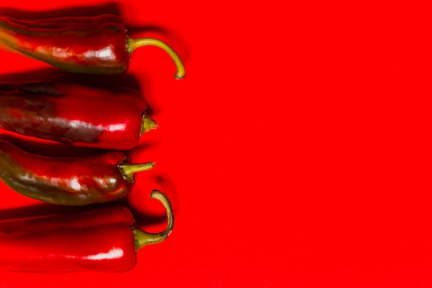Red hot chili pepper vegetable on a red background