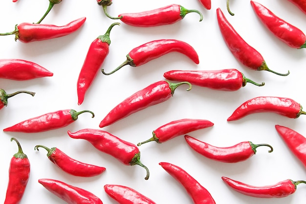 Red hot chili pepper on white background. stack of vegetables.