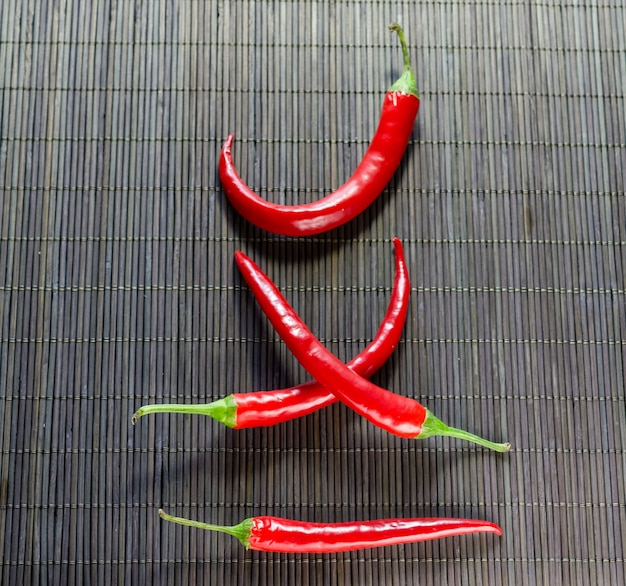 Red hot chili peppers on bamboo napkin