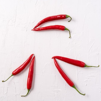 Red hot chili peppers pattern on white background,