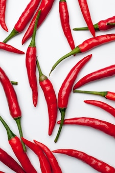 Red hot chili peppers on white background