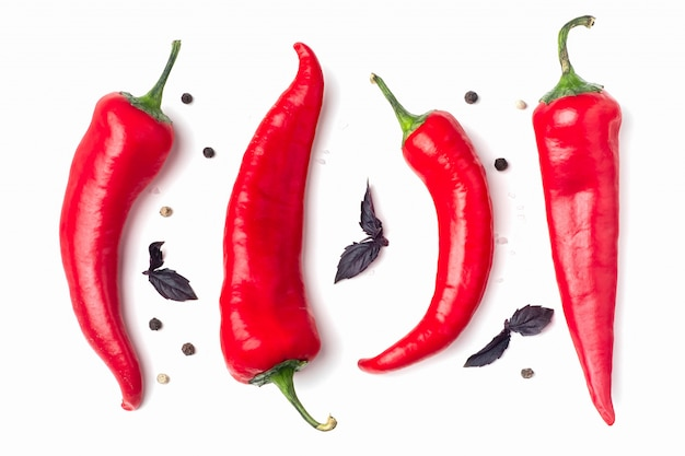 Red hot chili peppers on a white surface,