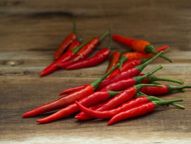 Red hot chili peppers on wooden table