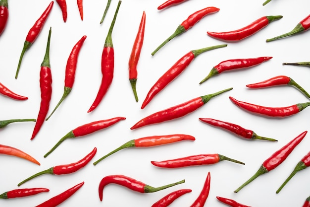 Red hot chilli pepper on white background, flat lay, top view
