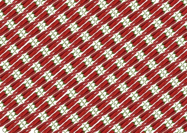 Красный острый перец чили как фон на белом