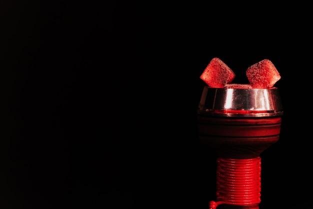 Red hot coals of a hookah in a shisha bowl