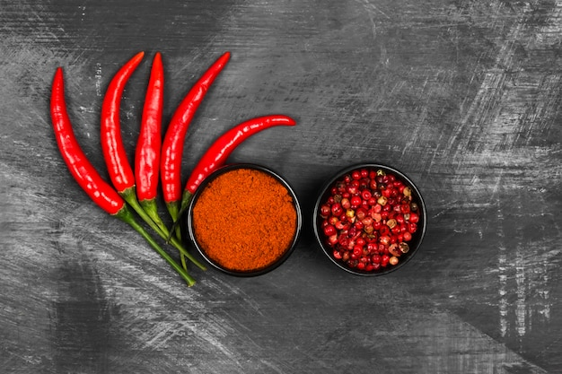 Red hot pepper on a black background. top view. food background