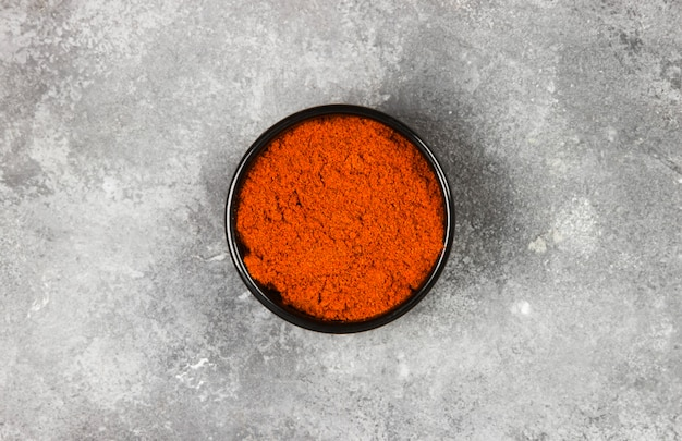 Red hot pepper on a gray background. top view. food background