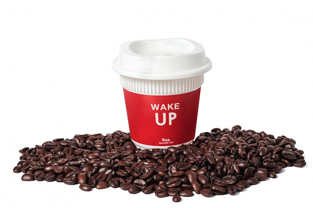 Red hot tall coffee take away cup and fresh coffee beans on white background .