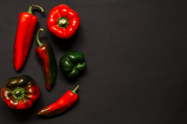 Red hot vegetable chilli pepper on a black background