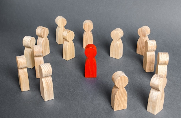 Red human figure surrounded by a group of people leader boss and leadership