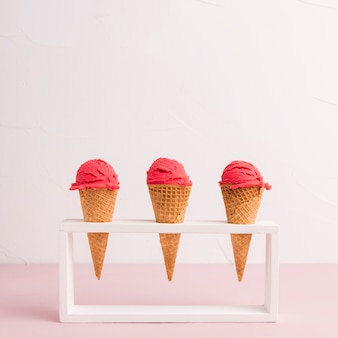 Red ice cream cones in holder