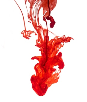 Red ink dropped into water isolated on white background.