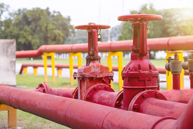 Red iron fire pipe and big valve for water set line up in a long row