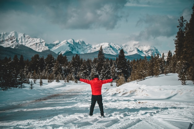 Red jacket man at morants curve, banff, alberta, canada