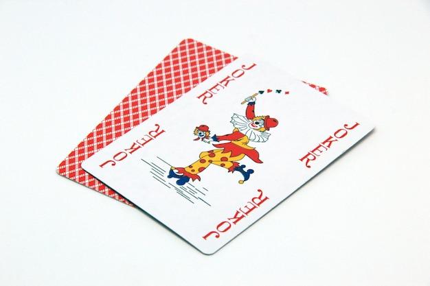 Red joker card on white background