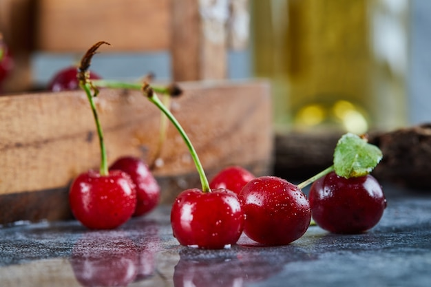 Red juicy cherry berries on a blue table