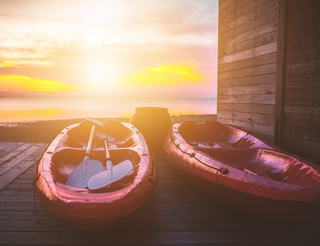 Red kayaks at sunset