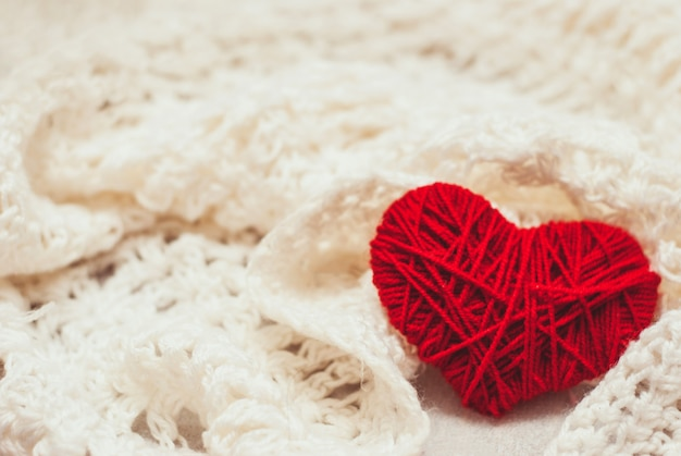 Red knitted heart symbol