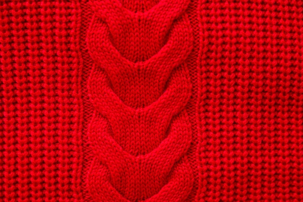 赤いニットの冬のセーター背景、赤い質感