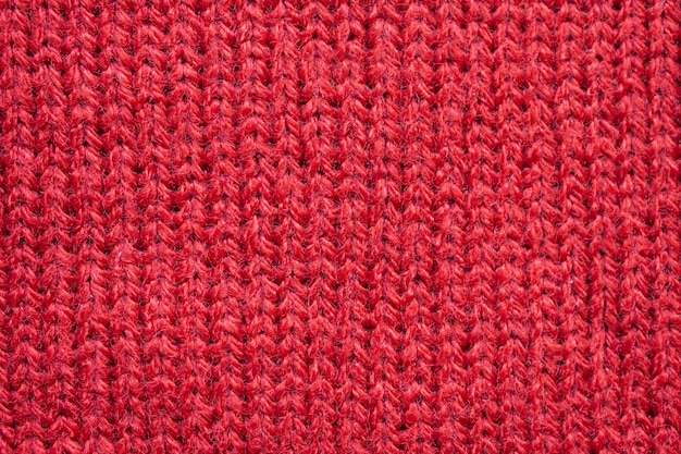Red knitted wool fabric texture background