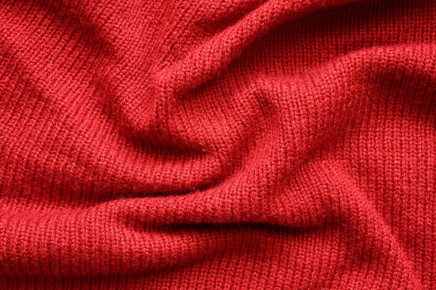 Red knitted wool texture background