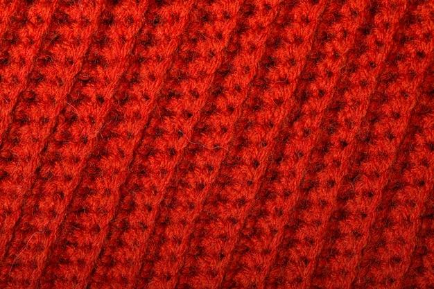 Красная вязаная шерстяная текстура может использоваться в качестве фона