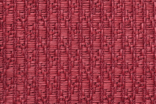 Red knitted woolen background with a pattern of soft, fleecy cloth. t
