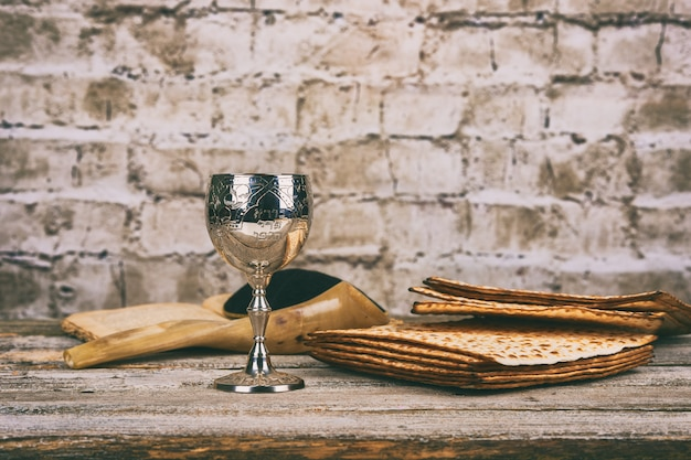 Red kosher wine with a white plate of matzah or matza