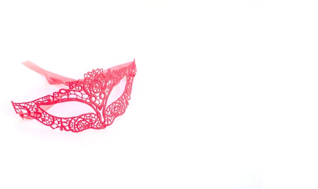 Red lace carnival mask on white background with copy space for mardi gras, brazilian, venetian carnivals