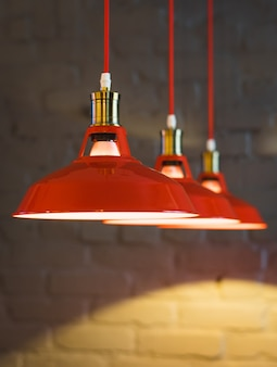 Red lamp over wooden table