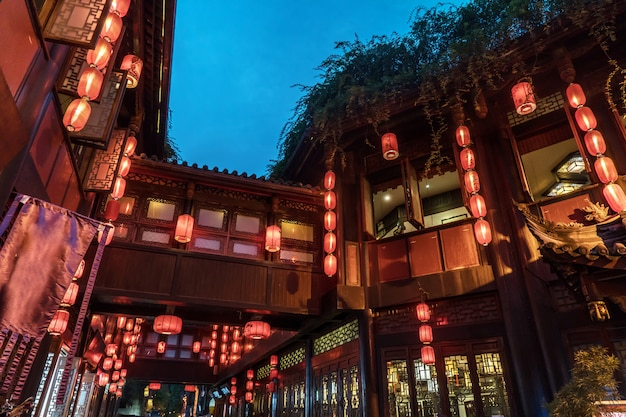 Red lanterns are hung in the attic in the ancient town at night, in chengdu, sichuan, chin