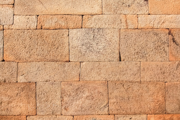 Red laterite stone wall texture background