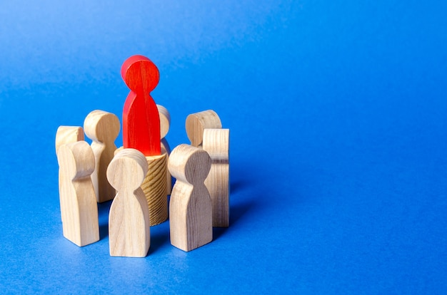 Red leader figure in the center circle of people power vertical creating a business team and its management